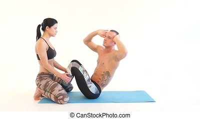 Young Couple Doing Sit Ups
