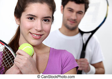 Young couple dressed for tennis