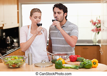 Young couple drinking a glass of wine
