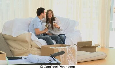 Young couple drinking champagne