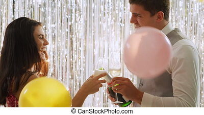 Young couple drinking champagne - Side view close up of a ...