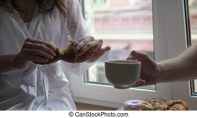 Young couple drinking coffee from cup in the morning. Breakfast at home