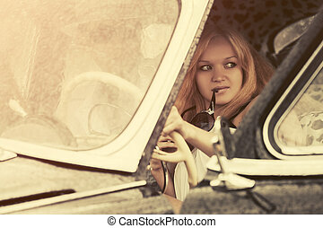 Young couple driving vintage car