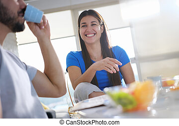 Young Couple Eating Breakfast At Home On Sunday