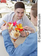 young couple eating sweet ice cream