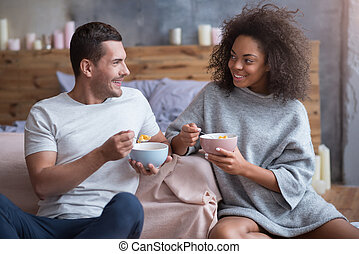 Young couple eating together in the morning