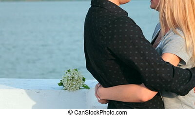 young couple embracing at the lake