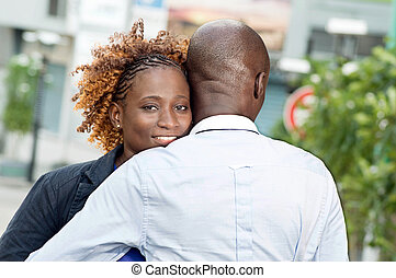 Young couple embracing . - This young couple embraces on the...