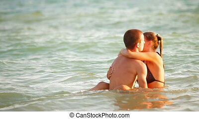 Couple Enjoying a Beach Vacation - Young Couple Enjoying a...