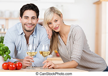 Young couple enjoying a glass of white wine
