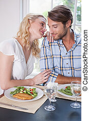 Young couple enjoying a meal together