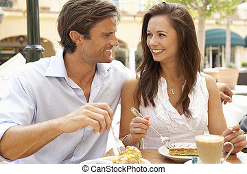 Young Couple Enjoying Coffee And Cake In Caf?