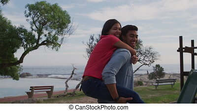 Young couple enjoying free time together - Front view of a ...