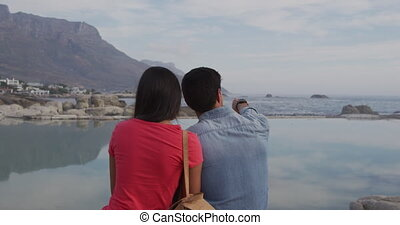 Young couple enjoying free time together - Rear view of a ...