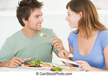 Young Couple Enjoying meal, mealtime Together