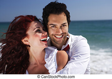 young couple enjoying on the beach laughing - young couple ...
