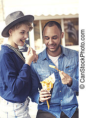 Young couple enjoying take out food