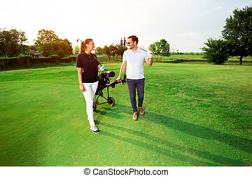 Young couple enjoying time on a golf course