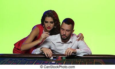 Young couple enjoys victory in a game of roulette