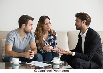 Young couple, family at meeting with realtor, interior designer