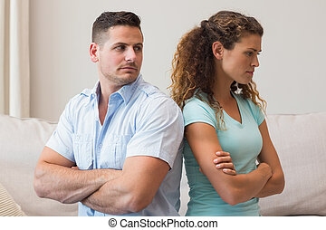 Young couple fighting in living room