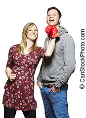 Young couple fighting with boxing gloves smiling