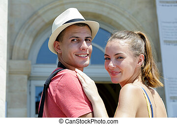 young couple finding the way on city break