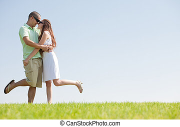young Couple Fooling Around On The park