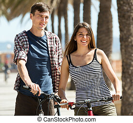friends spending free time with bicycles
