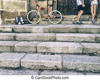 Young couple friendship with a fixed gear bicycle