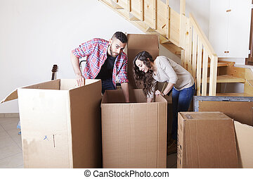 young couple furnishes the new home