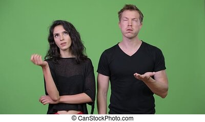Young couple getting bad news together - Studio shot of...