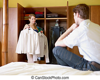 young couple getting dressed - caucasian couple getting ...