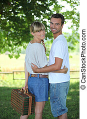 Young couple going on a picnic