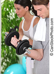 Young couple gym