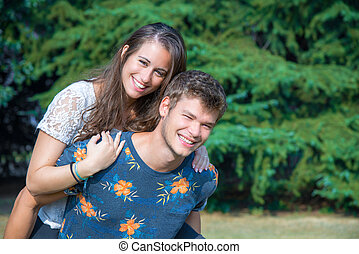 couple has fun in the park
