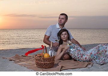 Young couple have romantic date on beach