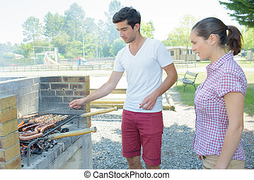 Young couple having a barbeque