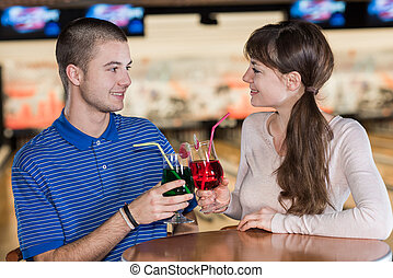 young couple having a drink