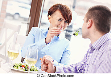 Young couple having a meal in a restaurant