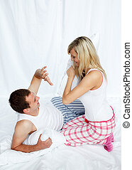 Young couple having a pillow fight