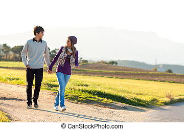 Young couple having a walk in countryside.