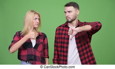 Young couple having different decisions together - Studio...
