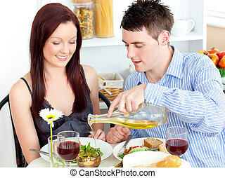 Young couple having dinner in the kitchen