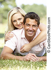 Young couple having fun in countryside