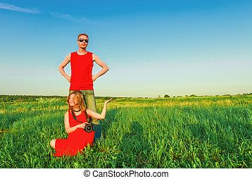 Young Couple Having Fun In The Green Field