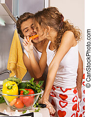 Young couple having fun in the kitchen - Young beautiful...