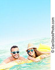 Young couple having fun in the sea