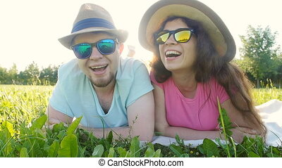 Young couple having fun on the grass in a park