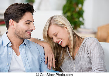 Young couple having fun together at home